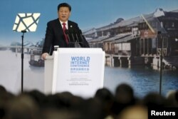 China's President Xi Jinping speaks during the opening ceremony of the 2nd annual World Internet Conference in Wuzhen town of Jiaxing, Zhejiang province, China, Dec. 16, 2015.