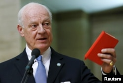FILE - U.N. mediator for Syria Staffan de Mistura delivers a statement after the opening of the Syrian peace talks at the United Nations European headquarters in Geneva, Switzerland, Jan. 29, 2016.