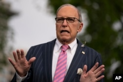 White House chief economic adviser Larry Kudlow talks to reporters at the White House, April 7, 2020.