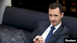 Syria's President Bashar al-Assad speaks during an interview with a German newspaper in Damascus, in this handout photograph distributed by Syria's national news agency SANA, Jun. 17, 2013.
