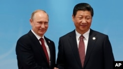 Tổng thống Nga Vladimir Putin và Chủ tịch Trung Quốc Tập Cận Bình.