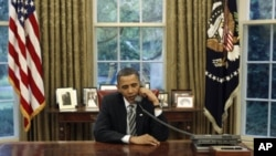US President Barack Obama talks on the phone in the White House Oval Office (file photo).