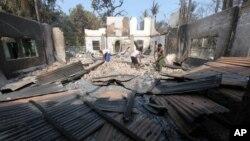 Muslims people remove debris from a damaged mosque following fresh anti-Muslim violence broke out in Okkan, 64 kilometers (40 miles) north of Rangoon, Burma, May 1, 2013.