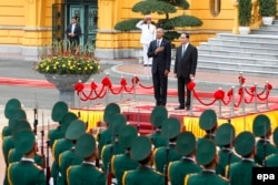 U.S. President Barack Obama (left) and Vietnam's President Tran Dai Quang review an honor guard at the Presidential Palace in Hanoi, Vietnam, May 23, 2016.