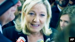 French far-right leader and National Front Party, Marine Le Pen speaks to the media after a news conference at party headquarters, Sunday, March 22, 2015, in Nanterre, western France.