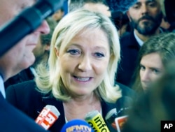 FILE - French far-right leader and National Front Party, Marine Le Pen speaks to the media after a news conference at party headquarters, March 22, 2015, in Nanterre, western France.