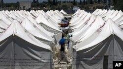 内乱导致许多叙利亚居民逃往土耳其。图为叙利亚难民集中居住的一处土耳其难民营