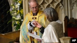 FILE - New Archbishop of Canterbury, Justin Welby, attends his enthronement ceremony at Canterbury Cathedral, southern England, March 21, 2013.