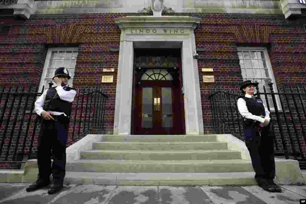 British police officers guard the entrance of St. Mary's Hospital exclusive Lindo Wing in London, July 22, 2013.