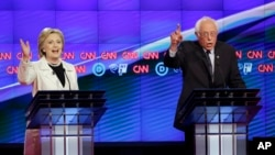 FILE - Democratic presidential candidates Hillary Clinton, left, and Sen. Bernie Sanders speak during the CNN Democratic Presidential Primary Debate at the Brooklyn Navy Yard, April 14, 2016.