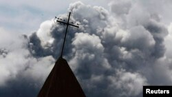 FILE - A cross is seen atop a church steeple in Indonesia's North Sumatra province, Nov. 30, 2013. Three churches on Indonesia's Sumatra Island were sealed by authorities Thursday.