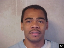 This July 8, 2004 photo of Patrick Dwayne Murphy was provided by the Oklahoma Department of Corrections. The Supreme Court is now hearing Oklahoma's plea to reinstate his murder conviction and death sentence.
