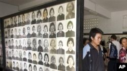 FILE - Cambodian villagers tour the Tuol Sleng genocide museum, former Khmer Rouge S-21 prison, in Phnom Penh, Cambodia. (AP Photo)