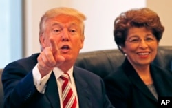 Donald Trump, during a Hispanic advisory meeting in New York, Aug. 20, 2016, is considering Jovita Carranza (right) as U.S. Trade Representative.