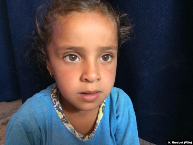 """After losing two children in the war with Islamic State, Zamin and Ibrahim Makhool's only remaining daughter, Amani, speaks of her old home fondly while living in a desert refugee camp outside Mosul. """"It was perfect,"""" she says. """"I want to go home,"""" in Hammam Alil, Iraq on June 21, 2017."""