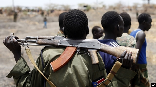 A South Sudanese soldier holds his rifle. Civilians own most of the small arms in South Sudan. (Reuters/File)