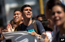 University students protest against President Nicolas Maduro in Caracas, Venezuela, Nov. 3, 2016.