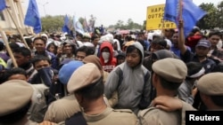 Public order officers block protesters demonstrating over labour issues in an industrial area of Tangerang on the outskirts of Jakarta, October 3, 2012.