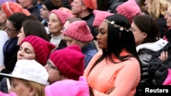 FILE - People listen to speeches at the Women's March in opposition to the agenda and rhetoric of President Donald Trump in Washington, Jan. 21, 2017.