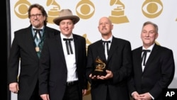 FILE - Members of the Earls of Leicester — from left, Jerry Douglas, Shawn Camp, John Warren and Charlie Cushman — pose with their award for best bluegrass album at the 57th annual Grammy Awards in Los Angeles, Feb. 8, 2015. The band has received eight International Bluegrass Music Association award nominations.