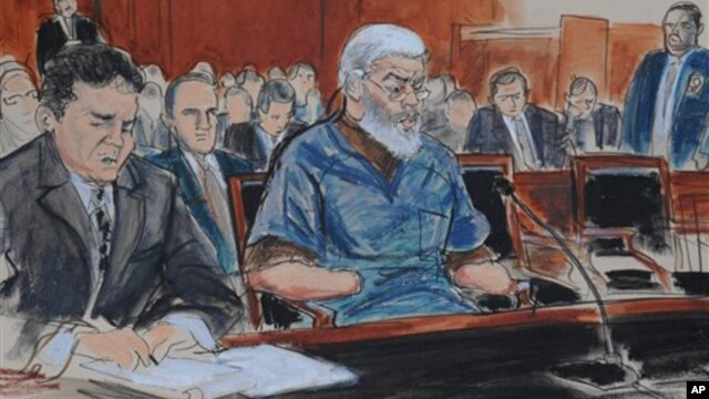 In this courtroom drawing, defense attorney, Jeremy Schneider (L) represents accused terrorist Abu Hamza al Masri (C) in Manhattan federal court in New York, October 9, 2012.