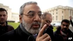 Bộ trưởng Bộ Thông tin Syria Omran al-Zoubi tại một cuộc họp báo ngắn khi đến trụ sở LHQ ở Geneva, Thụy Sĩ, ngày 26 tháng 1, 2014.