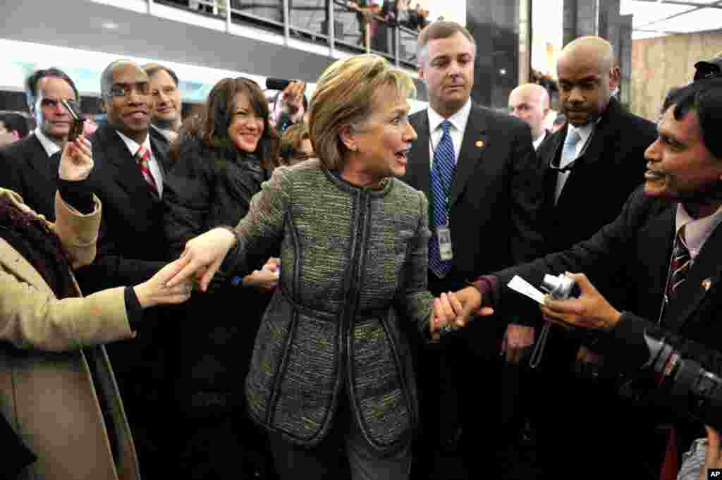 State Department employees welcome Hillary Clinton to the State Department building in Washington, January 22, 2009.