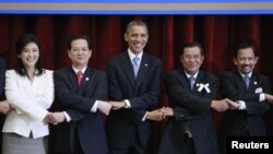 U.S. President Barack Obama participates in a family photo of ASEAN leaders during the ASEAN Summit at the Peace Palace in Phnom Penh November 19, 2012.