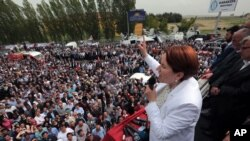 FILE - Meral Aksener, a former Interior minister and the main contester for leadership, addresses supporters as riot police sealed off a hotel to prevent thousands of dissidents in Turkey's opposition Nationalist Movement Party, the MHP, from holding a party congress to oust Devlet Bahceli, leader for the last two decades, in Ankara, Turkey, May 15, 2016.