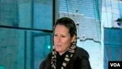 Aisha Gaddafi, anak perempuan Muammar Gaddafi berbicara dalam wawancara dengan stasiun TV pemerintah Libya (foto: 24/2).