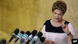 Brazil's President Dilma Rousseff speaks with journalists after meeting with her lawyers regarding impeachment proceedings against her at Planalto presidential palace, in Brasilia, Brazil, Dec. 7, 2015.