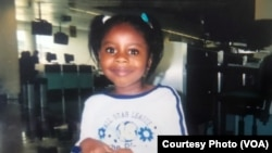 5-year-old Maya Hughes poses the day she left Sierra Leone. Maya's mother, Zainab Sesay, brought the pair to the West African country in 2003 to reconnect with their roots and introduce Maya to her great grandmother.
