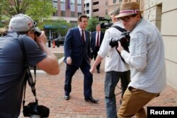 President Trump's former campaign manager Paul Manafort (C) arrives at U.S. District Court for a motions hearing in Alexandria, Virginia, May 4, 2018.