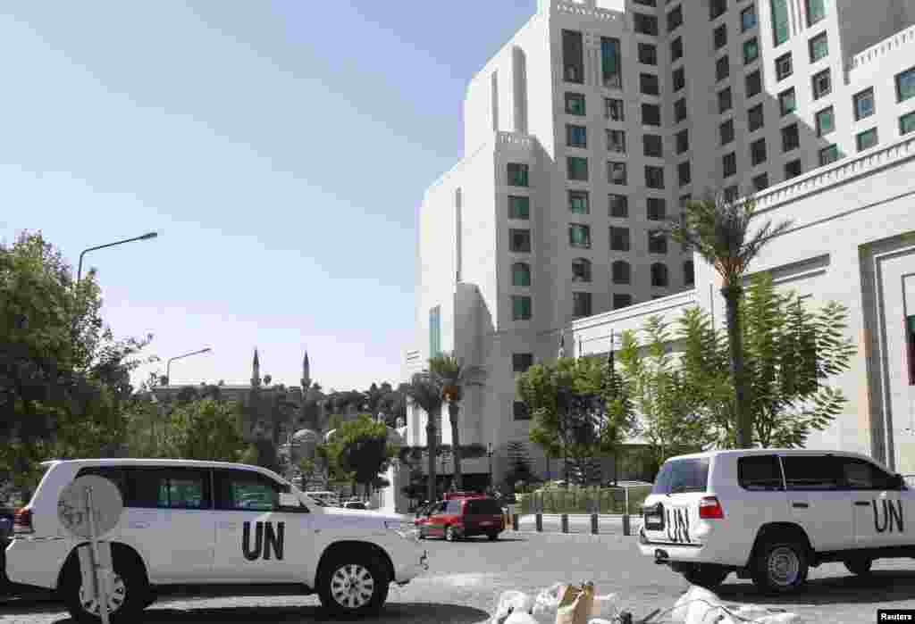 United Nations vehicles are parked in front of the Four Seasons hotel, where a team of experts from the Organisation for the Prohibition of Chemical Weapons (OPCW) is staying in Damascus, Oct. 22, 2013.