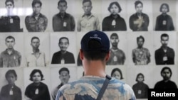 FILE-A tourist visits the Tuol Sleng Genocide Museum, also known as the notorious security prison S-21, in Phnom Penh March 3, 2015.