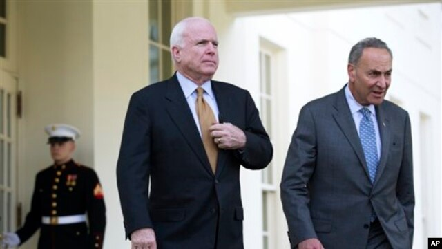 Sen. John McCain, left, and Sen. Charles Schumer, walk out of the White House in Washington, April 16, 2013