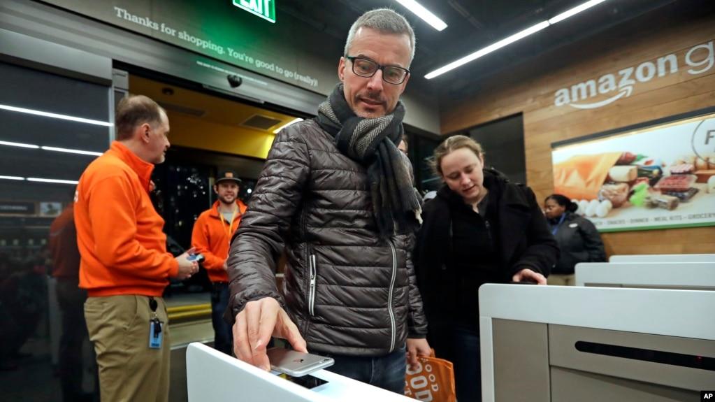 A customer scans his Amazon Go cellphone