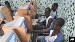 Ivorian youth checking an electoral commission website in a cyber cafe in Abidjan, Ivory Coast, on April 4, 2012.