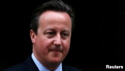 FILE - Britain's Prime Minister David Cameron leaves No. 10 Downing Street in London, Britain.