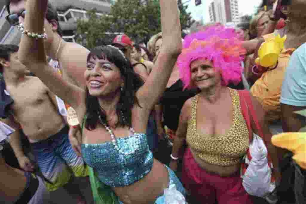 A reveler dances during the Banda de Ipanema carnival parade in Rio de Janeiro, Brazil, Saturday, Feb. 19, 2011. Hundreds of people gathered Saturday during one of the many parades which take place in the city before the famed 'Carnival' which runs March