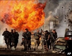 Josh Duhamel (fourth from left) plays Lennox and Tyrese Gibson (third from right) plays Epps in TRANSFORMERS: DARK OF THE MOON, from Paramount Pictures.