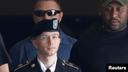 U.S. Army Private First Class Bradley Manning (C) departs the courthouse at Ft. Meade, Maryland, July 30, 2013.