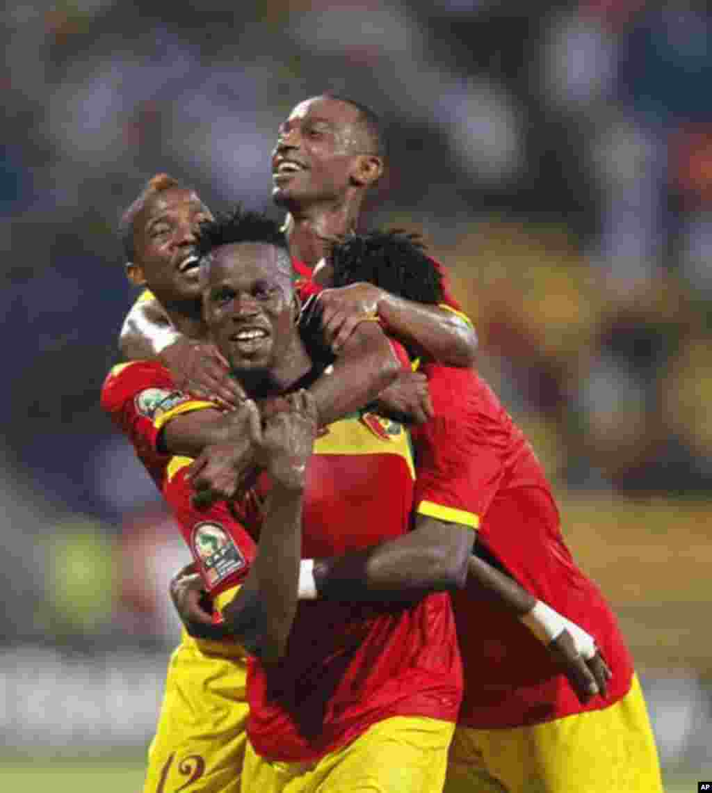 Guinea's Mamadou Dioulde Bah (C) celebrates his goal with teammates during their African Nations Cup Group D soccer match against Botswana at Franceville Stadium January 28, 2012.