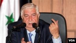Menteri Luar Negeri Suriah, Walid Mualim memperingatkan tindakan tegas bagi negara yang mengakui Dewan Nasional Suriah (9/10).