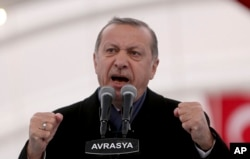 FILE - Turkey's President Recep Tayyip Erdogan gestures as he speaks in Istanbul, Dec, 20, 2016. Erdodan has been seeking broader powers since assuming the presidency in 2014.