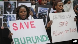Burundi nationals from across the U.S. and Canada, along with supporters, demonstrate outside U.N. headquarters, calling for an end to political atrocities and human rights violations in Burundi, April 26, 2016.