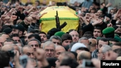 Lebanon's Hezbollah members carry the coffin of Jihad Moughniyah during his funeral in Beirut's suburbs January 19, 2015.