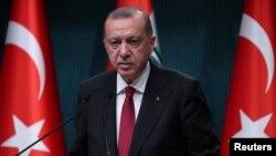 Turkish President Tayyip Erdogan attends a news conference in Ankara, Turkey, Aug. 14, 2018.
