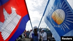 FILE - Supporters of the Cambodia National Rescue Party gather during a local election campaign in Phnom Penh, May 20, 2017.