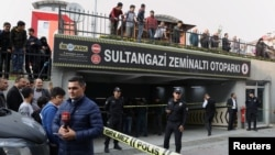Turkish police officers stand guard at the entrance of a car park where a vehicle belongs to Saudi Arabia's consulate was found, in Istanbul, Turkey, Oct. 22, 2018.